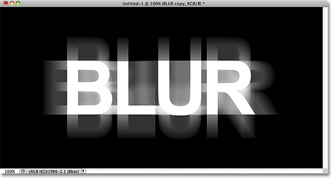 Horizontal and vertical motion blur has been added to the text. Image © 2011 Photoshop Essentials.com.
