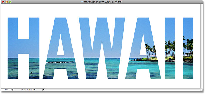 The photo now appears inside the text in Photoshop. Image © 2008 Photoshop Essentials.com.