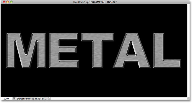 The metal text with Bevel and Emboss applied. Image © 2010 Photoshop Essentials.com.