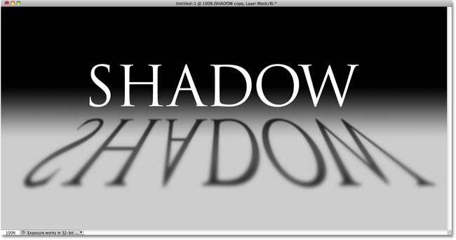The text shadow after inverting the layer mask. Image © 2010 Photoshop Essentials.com.