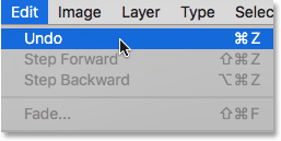 Choosing the Undo command under the Edit menu.