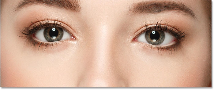 A close-up of the woman's eyes from the upscaled Smart Object.