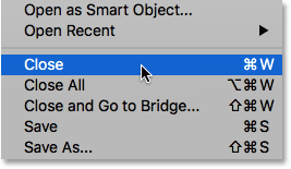 Choosing the Close command from under the File menu.