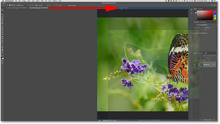 Moving a tab between document windows in Photoshop.