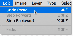 Choosing the Undo Paste command from under the Edit menu in Photoshop.