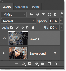 The Layers panel showing both photos in the same document in Photoshop.