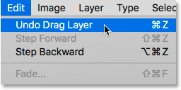 Choosing the Undo Drag Layer command from the Edit menu in Photoshop.