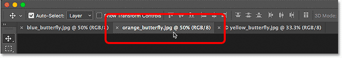 Selecting the middle document tab in Photoshop.