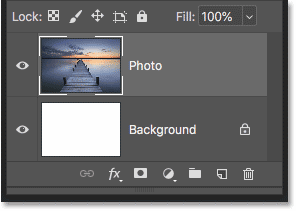 The Layers panel showing the image on its own layer above the Background layer.