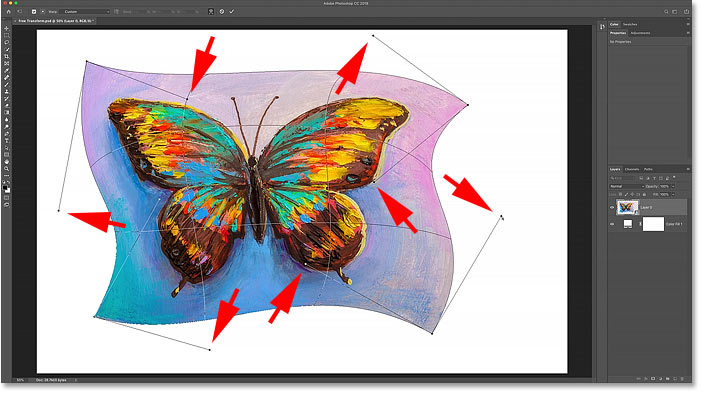 Warping the image in Photoshop by dragging the control points.