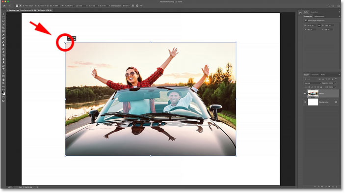 Using Photoshop CC's legacy Free Transform command to scale the image proportionally.