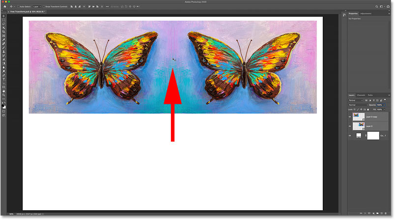 Dragging both copies of the image into the upper half of the canvas in Photoshop