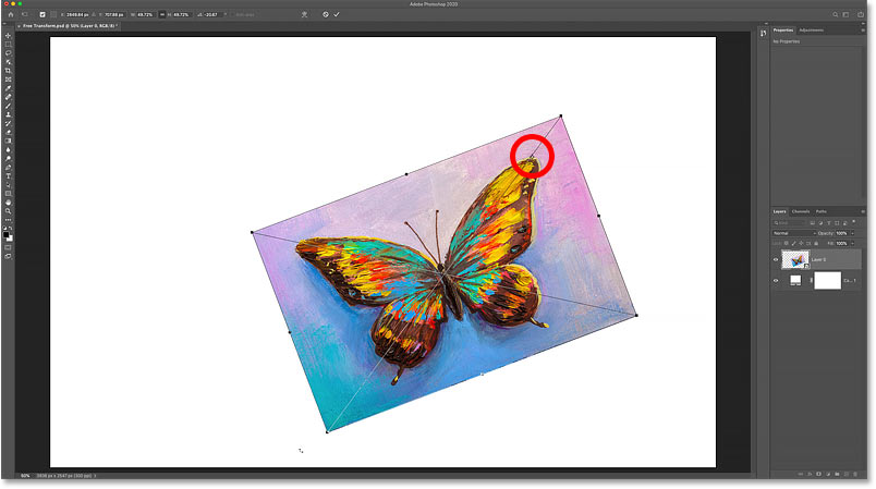Rotating the image around the new Free Transform Reference Point in Photoshop