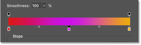 A new color has been added to the gradient in Photoshop's Gradient Editor