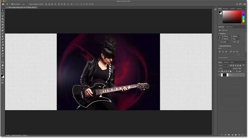 More canvas space has been added to both sides of the photo in the Photoshop document