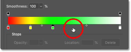 Adding a third new color stop below the gradient in Photoshop's Gradient Editor