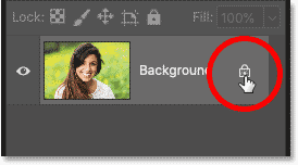 Unlocking the Background layer by clicking the lock icon in Photoshop's Layers panel