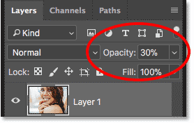 Lowering the opacity of the top layer to 30 percent