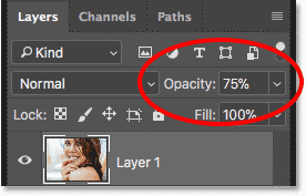 Lowering the opacity of the top layer to 75 percent