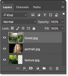 The Layers panel showing all three images on separate layers.