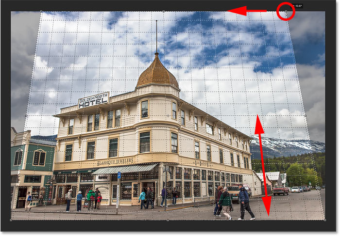 Matching the perspective grid line with the right side of the building to correct perspective in the image