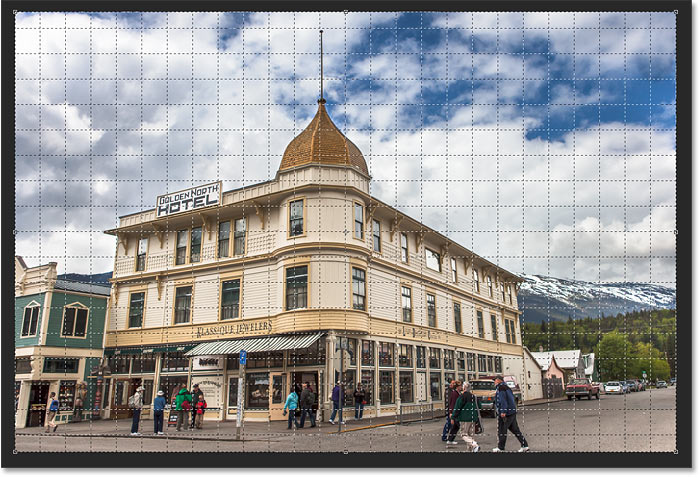 The Perspective Crop Tool adds a perspective grid to the image in Photoshop