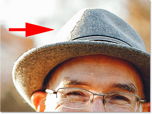 Select Subject missed part of the man's hat