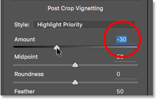 Adjusting the Post Crop Vignetting Amount slider in the Camera Raw Filter dialog box