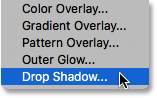 Selecting Drop Shadow from the list of layer styles. Image © 2016 Photoshop Essentials.com