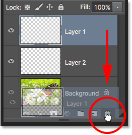Dragging a layer down into the Trash Bin. Image © 2016 Photoshop Essentials.com