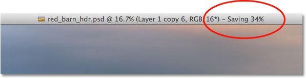 The save progress indicator at the top of the document window in Photoshop CS6.