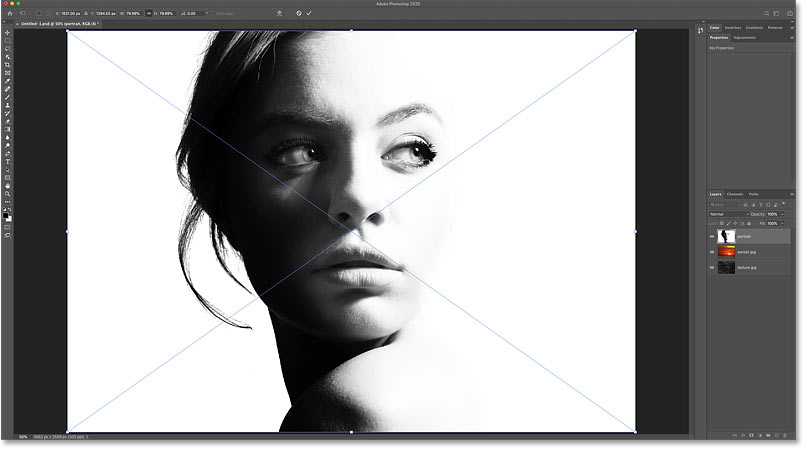 Photoshop opens the Free Transform command before placing the image into the document