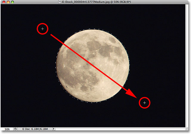 Drawing an elliptical selection around the moon.