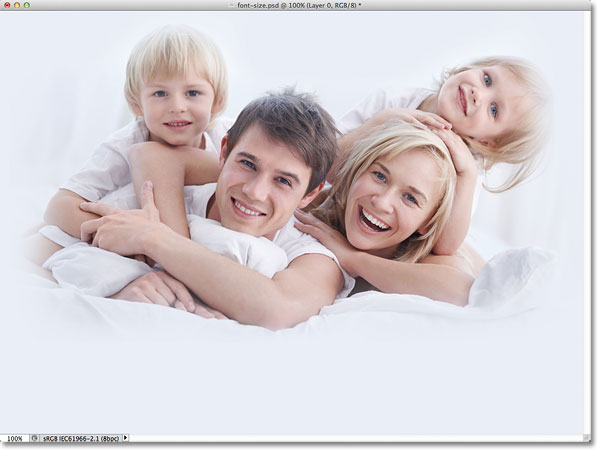 A photo of a couple with two children. Image licensed from Fotolia by Photoshop Essentials.com