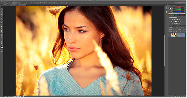 young woman portrait in yellow autumn field. Image licensed from Shutterstock by Photoshop Essentials