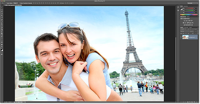 Man carrying girlfriend on his back in front of Eiffel tower. Image 109160954 licensed from Shutterstock by Photoshop Essentials