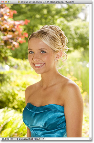 A photo of a teenage girl in a blue dress. Image licensed from Fotolia by Photoshop Essentials.com