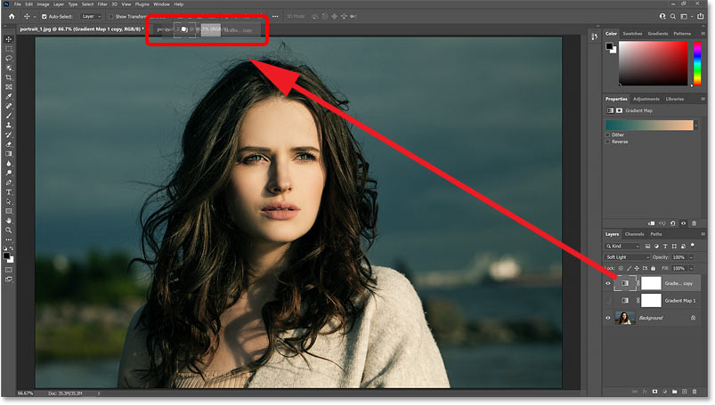 Dragging the Gradient Map adjustment layer from the Layers panel onto the second document's tab.