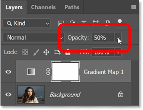 Lowering the Gradient Map adjustment layer's opacity.