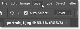 Opening the Layer menu in Photoshop's Menu Bar
