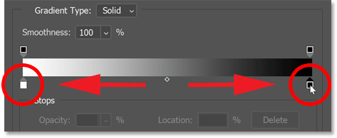 Swapping the positions of the black and white color stops in the gradient.