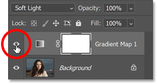 Turning off the original gradient map in Photoshop's Layers panel.