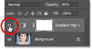 Clicking the Gradient Map adjustment layer's visibility icon.