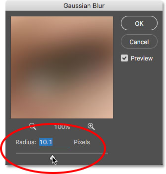 Increasing the Radius value in the Gaussian Blur dialog box. Image © 2016 Photoshop Essentials.com