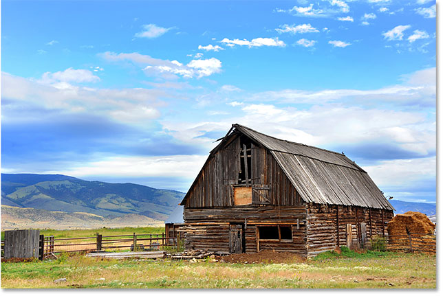 Barn backed by mountains. Image 113710336 licensed from Adobe Stock by Photoshop Essentials.com