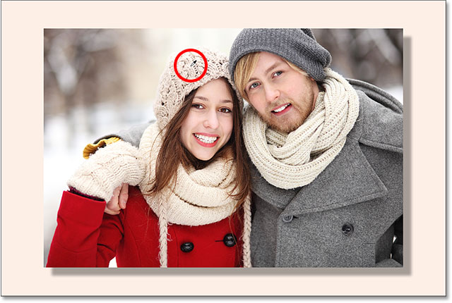 The color of the woman's hat is a better choice for the border.
