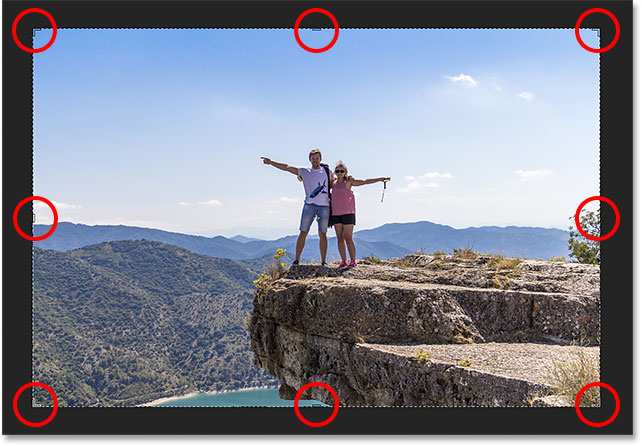 Photoshop places a crop border and crop handles around the image.