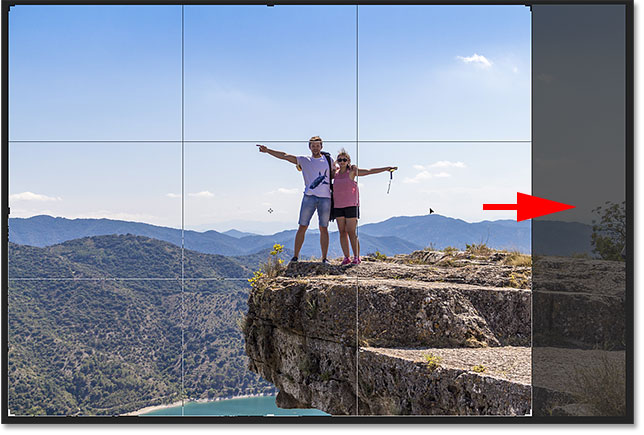 Clicking and dragging the image to move it inside the crop border.