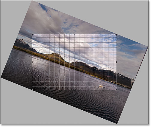 Photohop keeps the crop border within the image boundaries as you rotate.