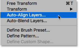 Selecting the Auto-Align Layers command from under the Edit menu.